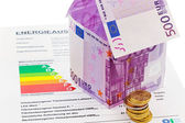 House from € banknotes and energy performance certificate — Stock Photo