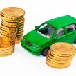 Model car and coins. car costs - Stock Photo