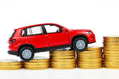 Model car and coins. car costs — Stock Photo