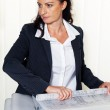 Architect with building plan in the office. — Stock Photo