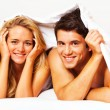 Stock Photo: Couple has fun in bed. laughter, joy and eroticism