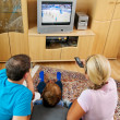 Family watching television with tv — Stock Photo