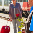 Older elderly couple at the railway station — Stock Photo