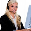 Woman with headset and computer hotline at — Stock Photo