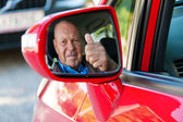 As senior drivers in the car. — Stock Photo