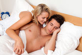 Couple has fun in bed. laughter, joy — Stock Photo