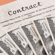 Dollar currency notes and english contract - Stock Photo