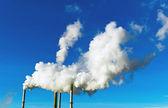 Smoking chimneys of a factory — Stock Photo