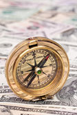 Dollar currency notes and compass — Stock Photo