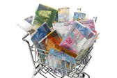 Delle banconote del franco svizzero con carrello — Foto Stock