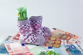 Children's socks and € bills — Stock Photo