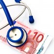 Stethoscope and euro banknote - Stock Photo