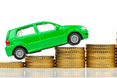 Car and coins. rising car costs — Stok fotoğraf