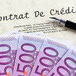 Euro banknotes and credit agreement (french) - ストック写真
