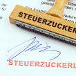 Stock Photo: Wood stamp on document: tax treat