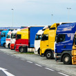 Stock Photo: Trucks parking on