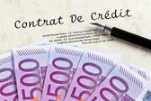 Euro banknotes and credit agreement (french) — Stock Photo