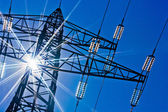 Powerline with sun — Stock Photo