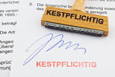 Wood stamp on the document: 25% withholding tax — Stock Photo