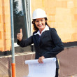 Stock Photo: Architects with blueprint at construction site