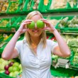 Woman in the purchase of fruit and vegetables — Stock Photo #11657653