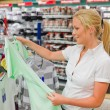Stock Photo: Woman on the purchase of clothing