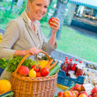 Woman at the fruit market with shopping basket — Stock Photo