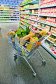 Shopping trolley in a supermarket — Stock Photo