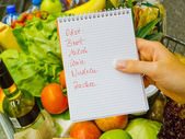 Shopping list at the supermarket (german) — 图库照片