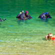 Stock Photo: Divers in lake