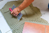 Tiler at work — Photo