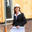 Architects with blueprint at construction site — Stock Photo