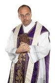 Catholic priest with bible in church — Stock Photo