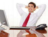 Successful managers sitting at desk — Stock Photo