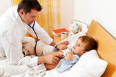 Doctor house call. examines sick child. — Stock Photo