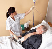 Nurse gives a patient a infusio — Stock Photo