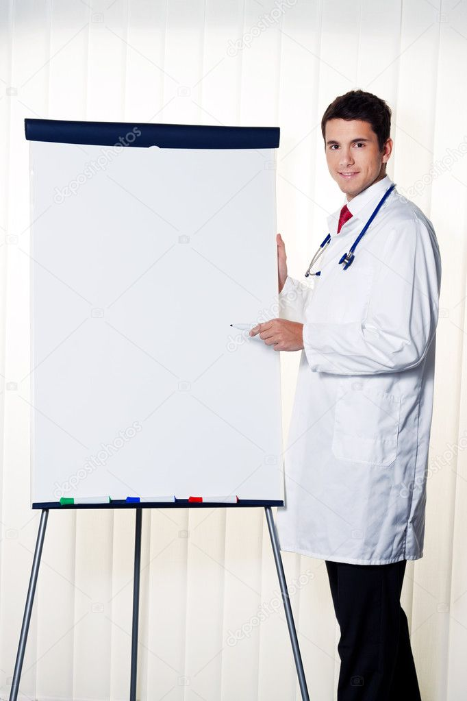 Successful doctor with a flip chart during a presentation in meeting — Stock Photo #11861056
