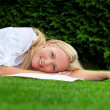 Stock Photo: Womis to relax in meadow