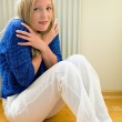 Woman sits in front of radiators — Stock Photo #11888415