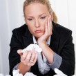 Woman in office with crumpled paper - Photo