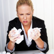 Woman in office with crumpled paper - Stockfoto