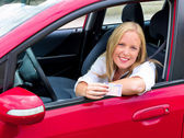 Young woman holding a driving license — Stock Photo
