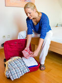 Woman pack your bags for vacation travel — Stock Photo