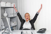 Successful young woman in an office — Stock Photo