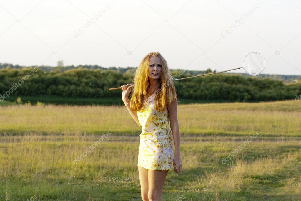 A young girl in a short dress in the trees  Stock Photo #10972883