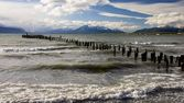 The historical remains of the pier on a lake in Puerto Natales — Stock Photo