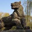 Stone lion is common decoration of parks — Stock Photo #11045301