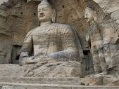 Huge statues of Buddha carved into the rock — Stock Photo