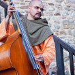 Stock Photo: Medieval musiciplaying double bass