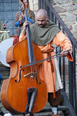 Medieval musician playing the cello — Stock Photo